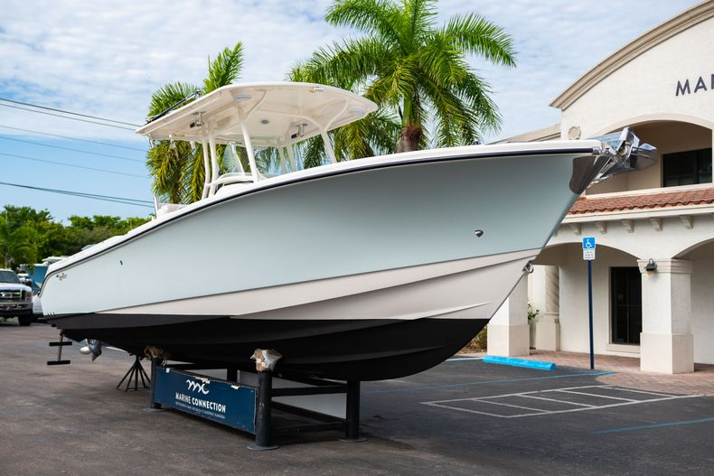 Thumbnail 1 for Used 2012 Edgewater 318CC Center Console boat for sale in West Palm Beach, FL