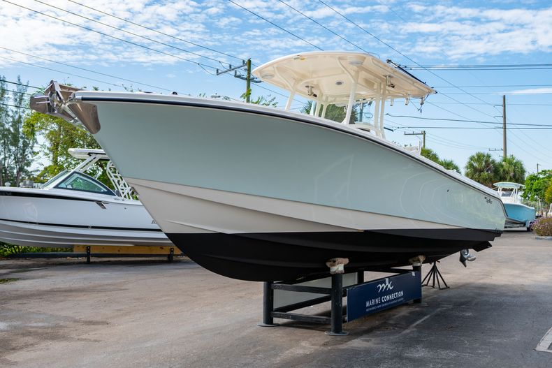 Thumbnail 4 for Used 2012 Edgewater 318CC Center Console boat for sale in West Palm Beach, FL