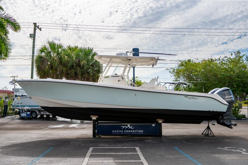 Thumbnail 6 for Used 2012 Edgewater 318CC Center Console boat for sale in West Palm Beach, FL
