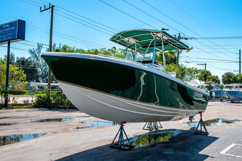 Thumbnail 4 for Used 2004 Bluewater 2350 Center Console boat for sale in West Palm Beach, FL