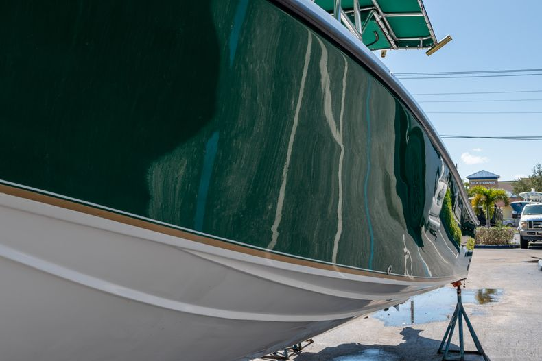 Thumbnail 5 for Used 2004 Bluewater 2350 Center Console boat for sale in West Palm Beach, FL
