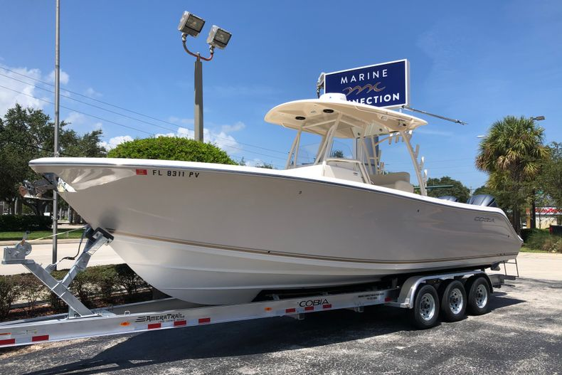 Thumbnail 1 for Used 2015 Cobia 296 Center Console boat for sale in Vero Beach, FL